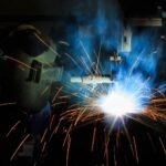 Picture of a person using a flux-cored arc welder.