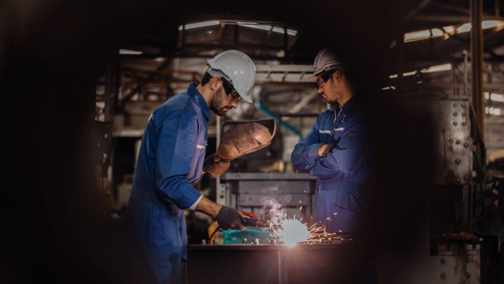Picture of a man using a flu-cored welder