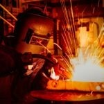 Picture of a person welding.